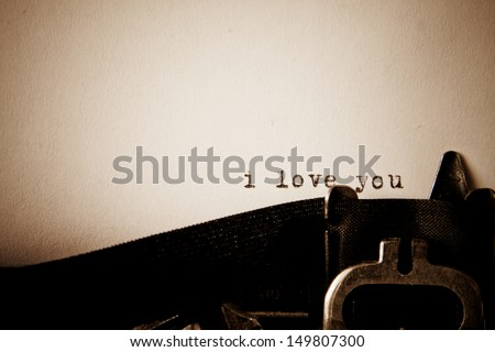 I love you message type on old typewriter - stock photo