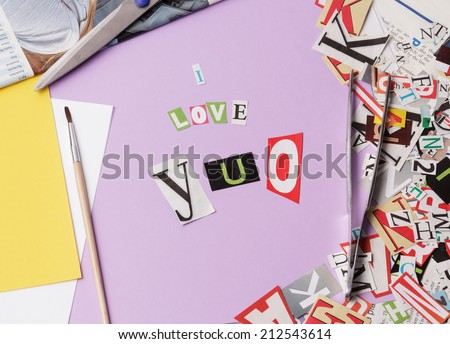 I love you - ransom note style on violet background - stock photo