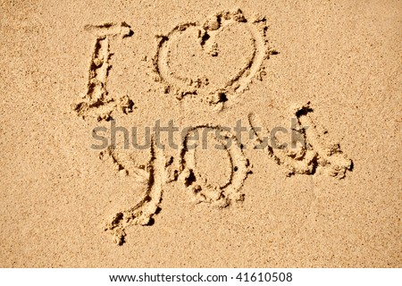 I love you sign on sand beach - stock photo