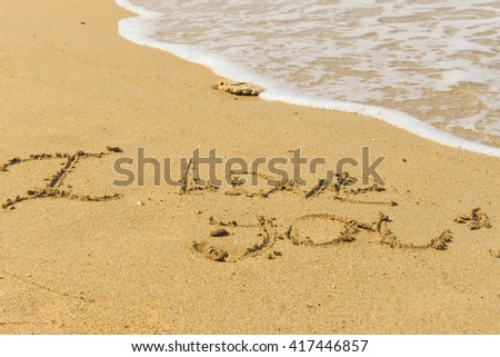 I love you text on sandy beach of Thailand with edge of sea