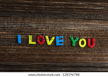 i love you text on wooden background - stock photo