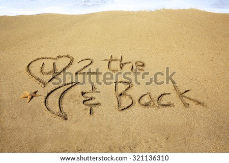 I Love You to the moon and back, a message drawn in the sand at the  beach.  - stock photo