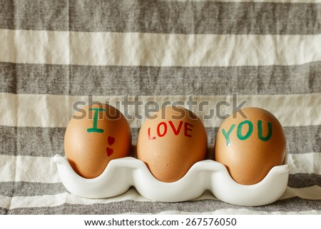 I LOVE YOU word on shell eggs - stock photo