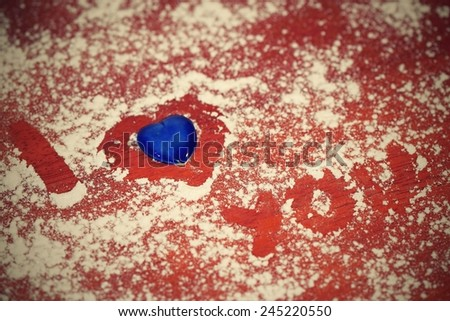 I love you,  written in sugar on wooden background. Wishes for Valentine's Day - stock photo
