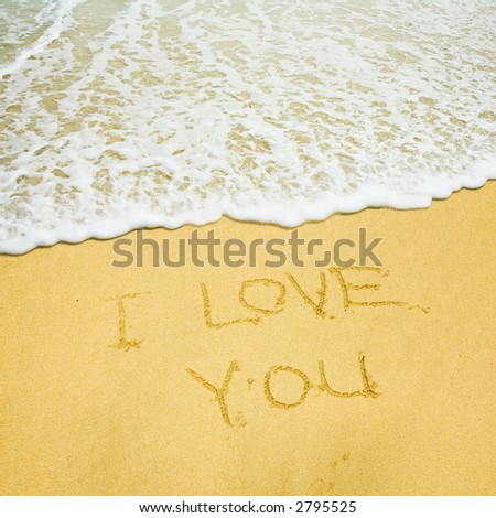 I love you written in the sandy beach - stock photo