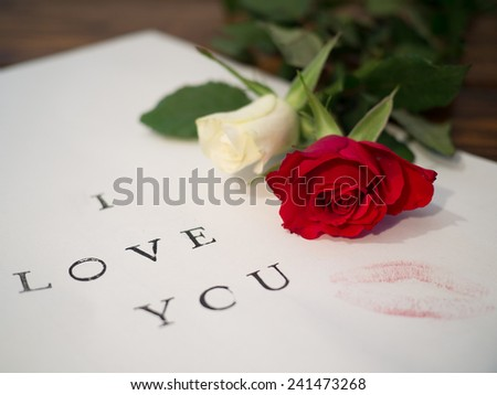 I LOVE YOU written on a letter with roses and a lipstick kiss - stock photo