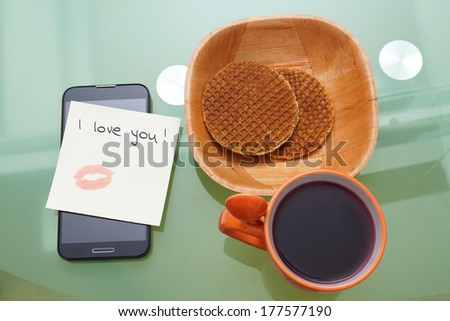 i love you written on a ticket with kiss with lipstick  on the smart phone - stock photo