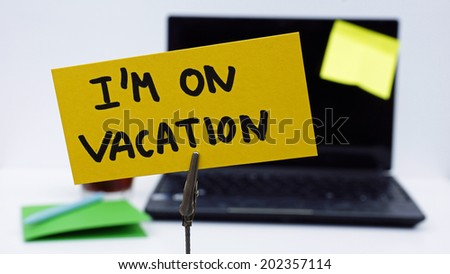 I'm on vacation written on a memo at the office - stock photo