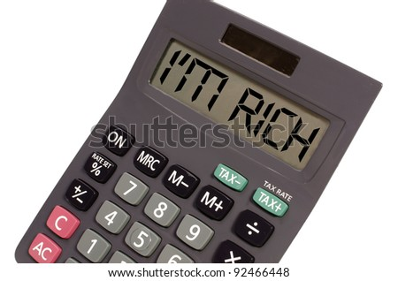 I'm rich written on display of an old calculator on white background in perspective - stock photo
