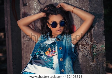 I'm sexy and I know it Closeup portrait headshot beautiful brunette young woman with round retro style sunglasses isolated graffiti grey background wall. Positive human emotion face expression feeling - stock photo