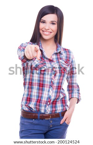 I made my choice! Attractive young smiling woman looking at camera and pointing you while standing isolated on white - stock photo