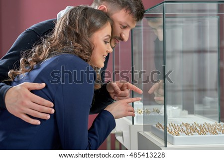 I see the one I want! Shot of a young woman shopping jewelry with her loving boyfriend