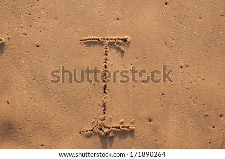 I text written in the sandy on the beach - stock photo