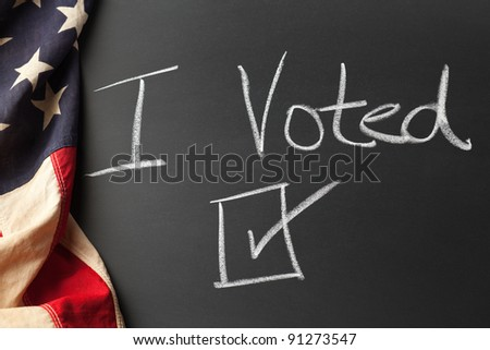 I voted sign with vintage American flag - stock photo