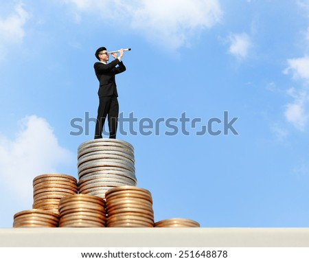 I want be rich - Business man stand on money with telescope ( spyglass ) looking forward for future business, asian - stock photo