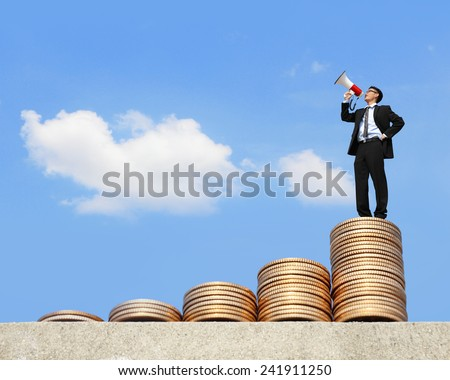 I want be rich - happy business man using megaphone shouting on money stairs with blue sky background, asian - stock photo