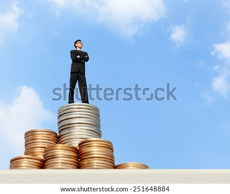 I want be rich - Successful business man stand on money with blue sky, asian male - stock photo