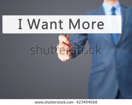 I Want More - Businessman hand holding sign. Business, technology, internet concept. Stock Photo - stock photo