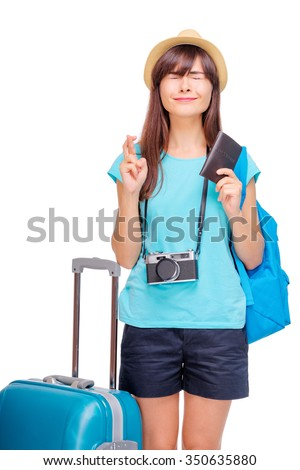 I wish! Dream about travel and vacation. Studio portrait of excited pretty young woman with fingers crossed. Isolated on white. - stock photo