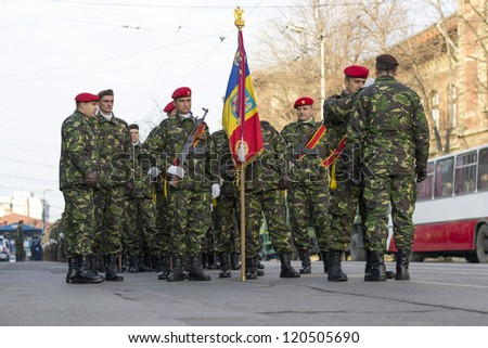 IASI, ROMANIA-DEC. 1: Soldiers preparing for the Military Parade on National Day of Romania, Union Square, December 1, 2012 in Iasi - stock photo