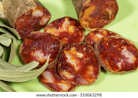 Iberian chorizo slices made of pork and spanish paprika. Gourmet product