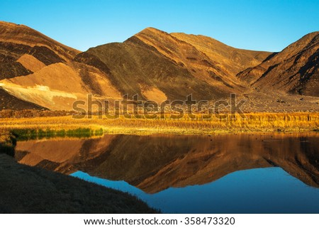 Ibex Hills Reflection Saratoga Spring Death Valley National Park California - stock photo
