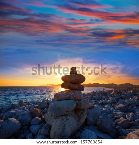Ibiza Cap des Falco sunset with desire stones at the beach in Sant Josep Balearic Islands - stock photo