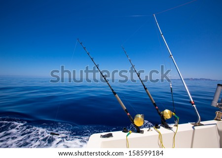 Ibiza fishing boat trolling with rods and reels in blue Mediterranean sea Balearic - stock photo
