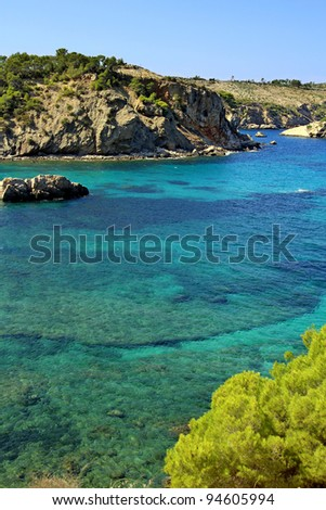 Ibiza island coast with clear turquise sea - stock photo