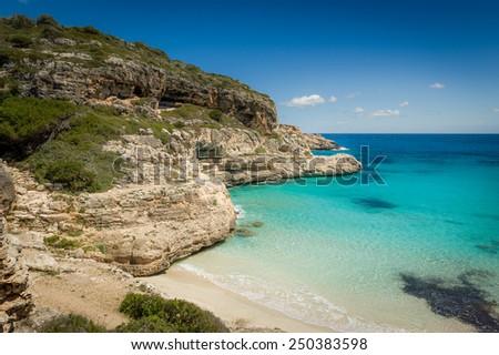 Ibiza paradise bay Cala Marmolis with famous wild sand beach and turquoise water. Baleares, Spain - stock photo