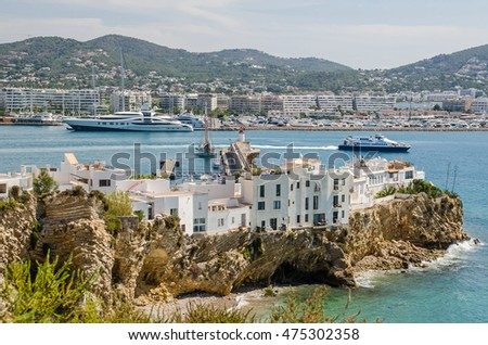 "Ibiza, Spain - June 3, 2016: View of Eivissa (Ibiza Town) with a part the old town and the modern part, called the Eixample (""extension"") with its  marina as seen from the cathedral"