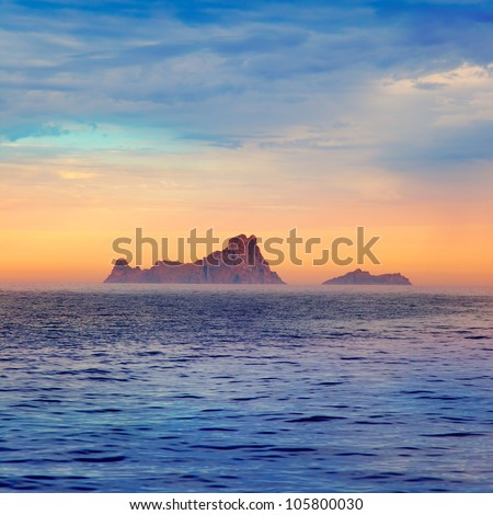 Ibiza sunset Es Vedra in Balearic islands view from Mediterranean sea - stock photo