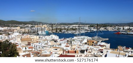 Ibiza Town, Spain - October 17, 2012: Panoramic view down from the castle to the old town and the harbor of Ibiza town. Ibiza, Spain. In the middle is the quay with the huge private yachts