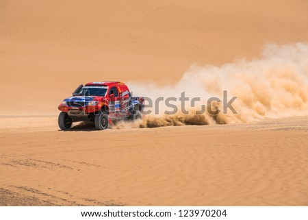 ICA, PERU - JAN. 06: Geoffrey Olholm (AUS) Drive his car during his participation on Rally Dakar 2013, JAN 06, 2013 in Ica, Peru. - stock photo