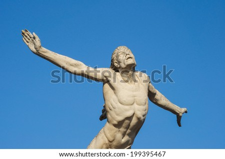 Icarus statue trying to fly to the sun