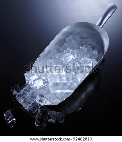Ice and spoon - stock photo