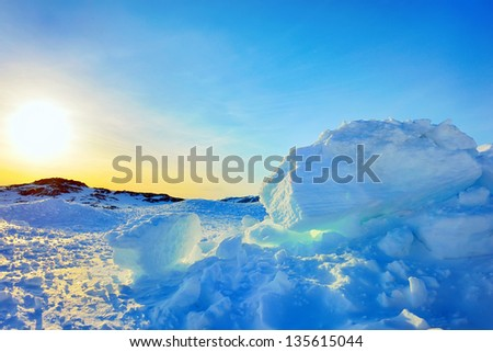 Ice and sun in Greenland in spring time - stock photo