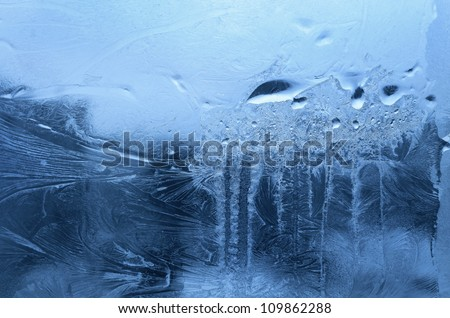 Ice and water drop on winter glass - stock photo