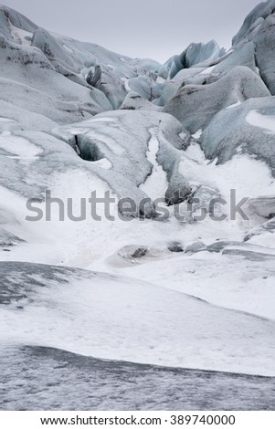 Ice blue colours of Skaftafell Glacial tongue covered in snow in Skaftafell National Park, Iceland