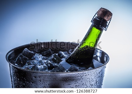Ice Bucket with ice and champagne