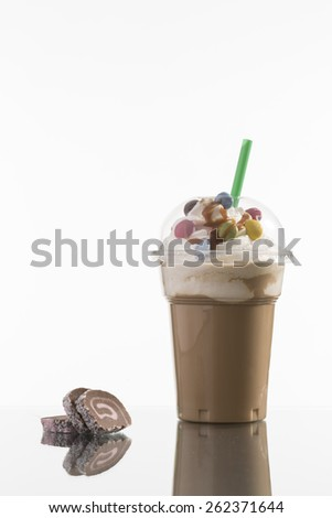 ice caffee in plastic take-away cup, decorated with whipping cream and bon-bons, advertisement for menu card - stock photo