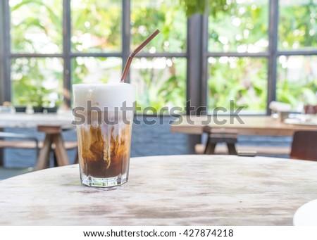 Ice cappuccino coffee in coffee shop - stock photo
