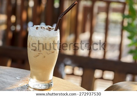 Ice cappuccino coffee on a wooden table - stock photo
