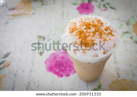 Ice cappuccino coffee with vintage background - stock photo