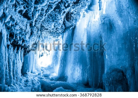 Ice cave in frozen waterfall Jagala, Estonia - stock photo