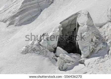 ice cave on the high-altitude glacier - stock photo