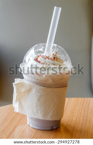 Ice chocolate frappe and whipped cream in the takeaway plastic cup - stock photo