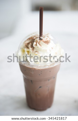 ice chocolate with whipped cream in the takeaway plastic cup, drink