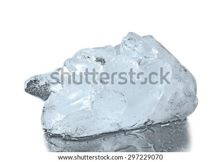 Ice. Chunk of ice on reflective surface - stock photo