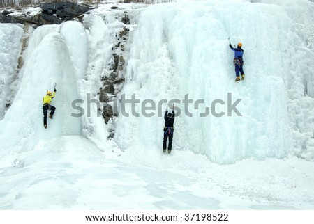 Ice-climbing a frozen waterfall